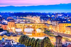 Florence, Tuscany, Italy - Ponte Vecchio and Palazzo Vecchio. Florence, Tuscany - Ponte Vecchio and Palazzo Vecchio at night, Renaissance architecture in Italy Royalty Free Stock Photos