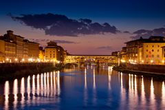 Florence, Tuscany - Panoramic view of the Ponte Vecchio by night stock photo