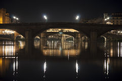 Florentine bridges by night with lights reflection Royalty Free Stock Photography