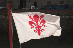 Florentine flag is red lily blazon on white background. Florentine flag is red lily blazon and white background. It was taken on the river side in Florence one Royalty Free Stock Photo