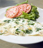 Florentine spinach egg white omelet. Feta cheese tomato and lettuce royalty free stock photo