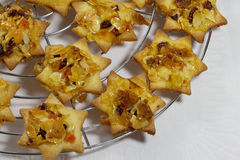 Florentine stars on cooling rack. Cut out cookies on cooling rack Royalty Free Stock Photography