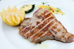 Florentine steak. Florentine style steak with lemon royalty free stock photography