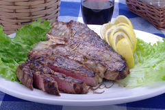 Florentine steak. On rustic tablecloth stock photo