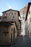 Florentine street to Duomo. Florentine street who leads to Duomo cathedral . Like every Street in the historic center of is narrow and charming Royalty Free Stock Image