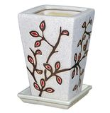 Florero bajo de piedra con el ornamento contra blanco Imagen de archivo libre de regalías
