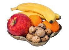 Florero con la fruta y la nuez Imagen de archivo libre de regalías