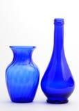 Florero y botella azules Fotos de archivo