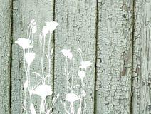 Flores abstractas en vieja textura de madera pintada del vintage Fotos de archivo libres de regalías