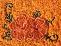Flores alaranjadas, bordado Fotografia de Stock Royalty Free