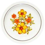 Flores amarillas de pintura en plato Imágenes de archivo libres de regalías