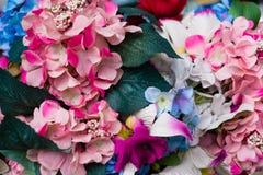 Flores artificiais bonitas Tons da cor pastel do vintage Fotografia de Stock