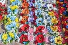Flores artificiais feitas do fundo da textura da tela imagem de stock