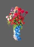 Flores artificiales coloridas en Gray Background, trayectoria de recortes Fotos de archivo libres de regalías