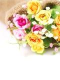 Flores artificiales hechas del paño en fondo blanco aislado Foto de archivo libre de regalías