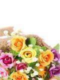 Flores artificiales hechas del paño en fondo blanco aislado Fotografía de archivo libre de regalías