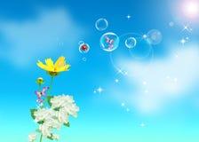 Flores, cielo azul Imagenes de archivo