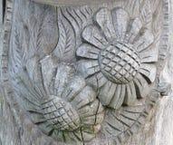 Flores cortadas en la madera Imagen de archivo libre de regalías