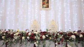 Flores das decorações na tabela dos pares filme