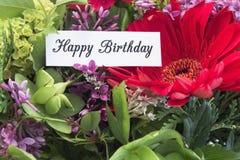 Flores de la primavera del withf de la tarjeta del feliz cumpleaños Fotos de archivo