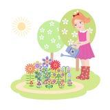 Flores de riego de la muchacha Fotos de archivo