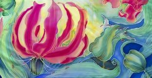 Flores del gloriosis con las hojas y los brotes - dibujo en la seda batik Flor asiática, africana Utilice los materiales impresos imágenes de archivo libres de regalías