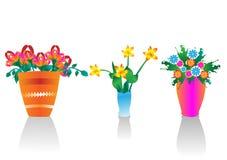 Flores del resorte en floreros Imagen de archivo