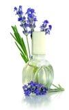Flores e óleo da alfazema Fotografia de Stock Royalty Free