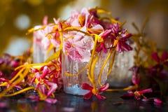 Flores en el vidrio Foto de archivo libre de regalías