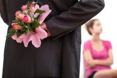 Flores escondendo do homem Imagem de Stock