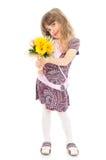 Flores felices de la explotación agrícola de la niña Imágenes de archivo libres de regalías