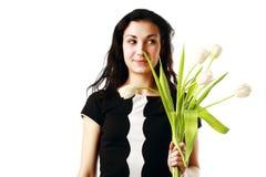 Flores felizes da terra arrendada da mulher Fotos de Stock Royalty Free