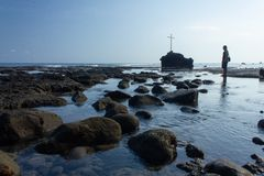 FLORES/INDONESIA-NOVEMBER 16 2012: A views of the beach of Watukrus, Flores, Indonesia. With rocks around the beach and the cross royalty free stock photography