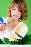 Flores molhando da menina Imagem de Stock Royalty Free