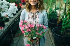 Flores nas mãos Fotos de Stock Royalty Free
