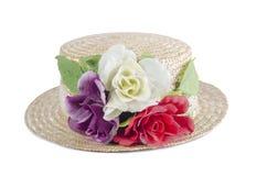 Flores no chapéu Fotografia de Stock