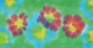 Flores pintadas en tela fotografía de archivo libre de regalías