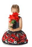 Flores que huelen de la niña Foto de archivo libre de regalías