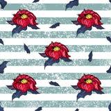 Flores vermelhas em umas listras brancas e azuis Fotografia de Stock Royalty Free