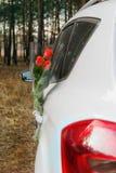 Flores y coche Imágenes de archivo libres de regalías