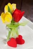 Flores y corazones Imagen de archivo libre de regalías
