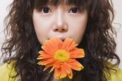 Flores y muchacha Foto de archivo