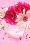 Flores y vela Fotografía de archivo libre de regalías