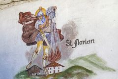 Florian - patron of the fire department. Painting on a house in the Oetztal, which shows St. Florian the patron saint of the fire brigade royalty free stock images