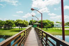 Wooden bridge over small lake. Florianopolis, Brazil. Februry, 2018. Wooden bridge over small lake Lagoa da Chica, Campeche, Floripa Royalty Free Stock Photography