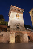 Florianska Gate by Night in Krakow Royalty Free Stock Photography