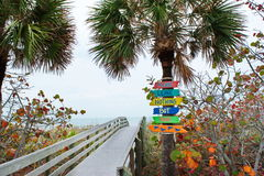 Florida Beach Signs. Colorful signs leading to the beach on the Gulf Coast of Florida encourage travelers to not leave any items or litter on the sands Royalty Free Stock Photo