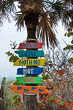 Florida Beach Signs. Colorful signs leading to the beach on the Gulf Coast of Florida encourage travelers to not leave any items or litter on the sands Royalty Free Stock Photography