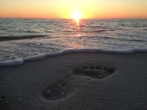 Florida Beach Sunset with Footprints in Sand stock image