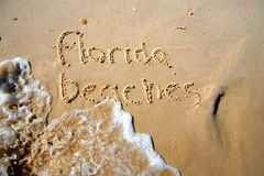 Florida Beaches. Written in the surf and sand Royalty Free Stock Photo